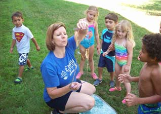 faculty-Alison-making-bubbles-for-kids