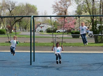 preschool-boys-on-playground-swings